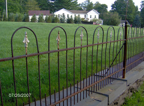 Walls and rebuilding old iron fence for Bronson Pinchot